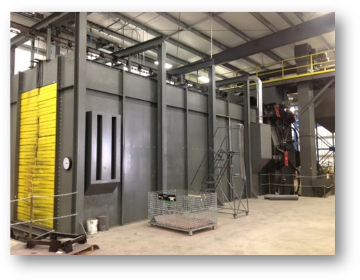Vertical monorail descaling machine shown with airblast touch-up room